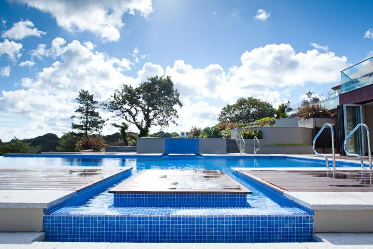 Swimming pools jersey spas jersey pools jersey for Infinity pool design uk